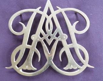 Colonial Williamsburg Queen Anne Cypher brass trivet hot plate