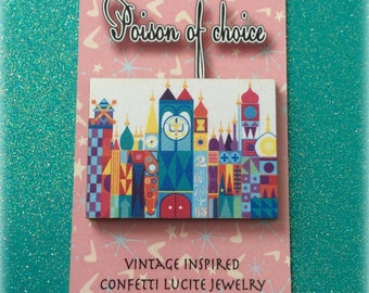 It's a small world brooch