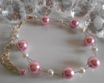 Wedding bracelet twist of white and old pink beads