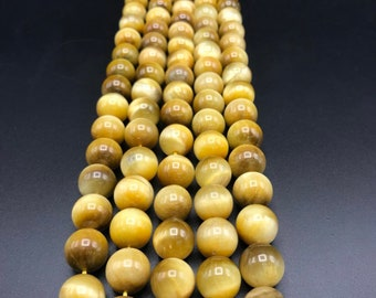 Beautiful GOLDEN TIGEREYE strand 6mm,8mm,10mm and 12mm .make your own necklaces or bracelets . Best healing stone