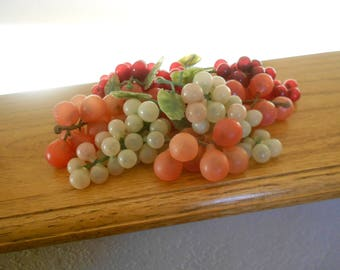 Vintage grape clusters.  Green and rosy red.