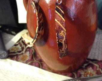 Burgundy carved, crescent shaped, gourd jewelry