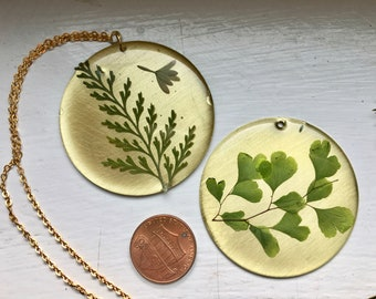 Large brass circle with pressed lacy fern necklace