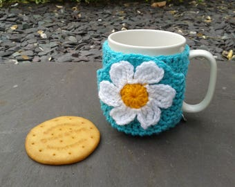 Daisy flower mug hug / mug cosy with biscuit / cookie pocket in aqua blue.
