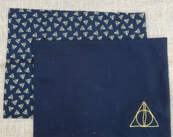2 reversable Deathly Hallows placemats
