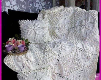 White knitted blanket, a blanket of motifs, a knitted blanket, a wool blanket, a pillow case, a pillow cover, a baby blanket, a blanket