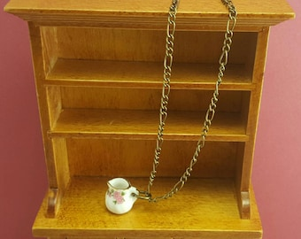 Necklace with miniature milk jug