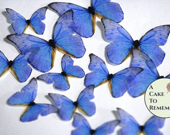 Blue edible butterflies, 12 wafer paper butterflies for wedding cake toppers. Butterflies for cake decorating and cupcake decorating.