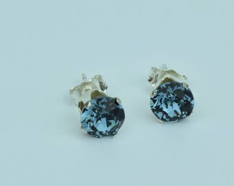 Denim blue Swarovski crystal sterling silver earstuds.Sparkly facet cut.Matching necklace available too.