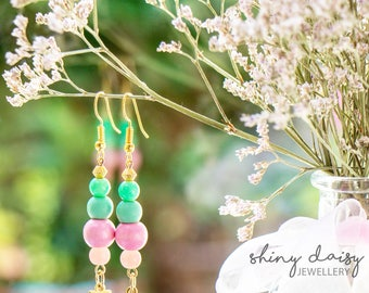 Bright handmade earrings with pearls beads and golden charms