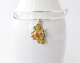 Busy buzzy bee - enameled in orange and green on a silver plated bangle bracelet