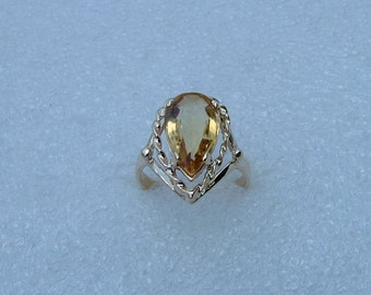 Gold and Citrine ring. 10 carat yellow gold ring set with a pear shaped Citrine measuring 12x8mms