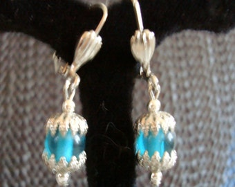 LEVER BACK HOOPS,  Aqua colored bead dangles in silvertone settings, drops 7/8 inch from shell front