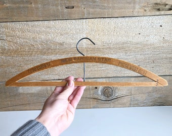 Wood hanger with advertising. Dry cleaning wooden hanger.