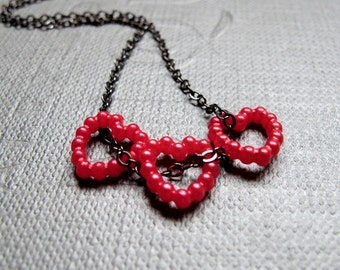 """CLEARANCE - Three Red Hearts mean I Love You Necklace // Red Faux Pearl Hearts // 17"""" Gunmetal Chain // Valentine Gift under 10"""