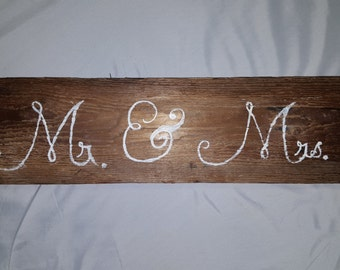 Rusic MR. and MRS. sign