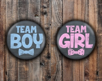 Chalkboard writing boy and girl gender reveal pins.  Blue and Pink.