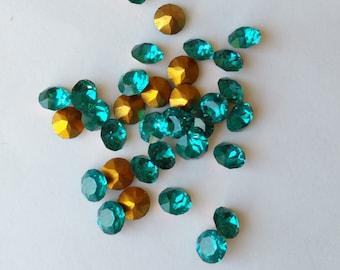 12 Swarovski blue zircon teal crystal rhinestone chatons with gold foil. 5mm