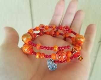 Red/orange/gold/silver beaded memory wire wrap bracelet!