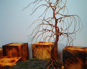 Handmade copper willow tree blowing in the wind
