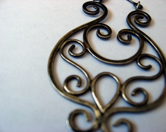 Silver wire scroll earrings with patina