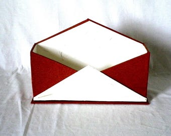 courier made cardboard skivertex and paper holder