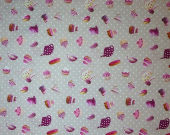 Fabric with pink sweets on grey background with white dots