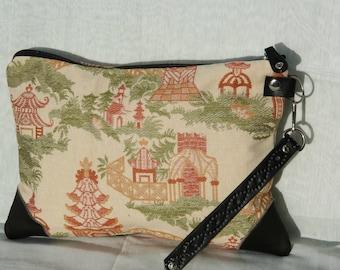 small handbag, clutch, fabric, leather.