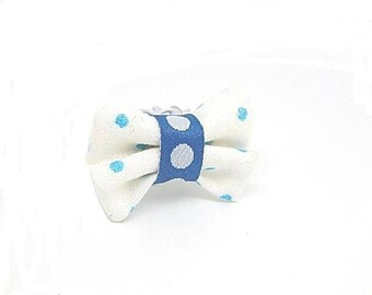 White and blue bow tie ring with polka dots