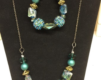 Teal green necklace with matching bracelet.