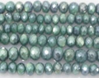 coated moonstone facetetd green very sparkling
