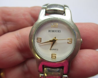 "Vintage lady's watch ""Rumours"" Quartz silver tone metal linked band with snap closure   used watch"