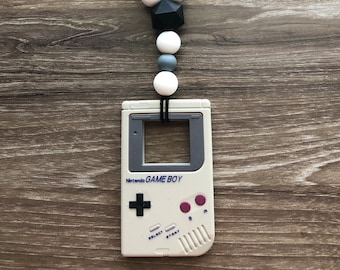 Gray gameboy carrier teether