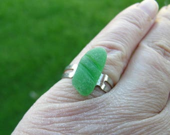 Unique hand crafted ridged green sea glass beach glass nugget set on a vintage 1970s adjustable silver tone ring