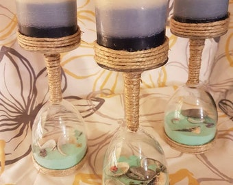 Set of three wine glasses and shells