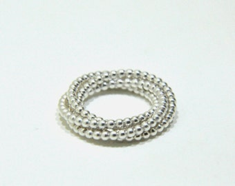 Interlaced silver ring from Jatemi
