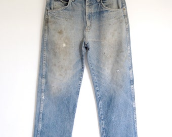 vintage mens destroyed jeans / faded grunge Wrangler patched work jeans / chew can / rivets distressed weathered / Made in USA / 33 x 30