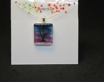 Original watercolor painting set under glass pendant