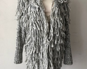 Knitted woman jacket color gray woman size universal .