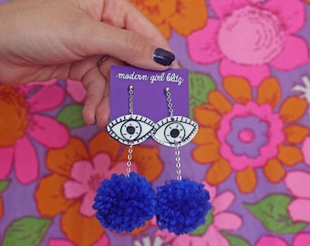 Eye Pom Pom Earrings