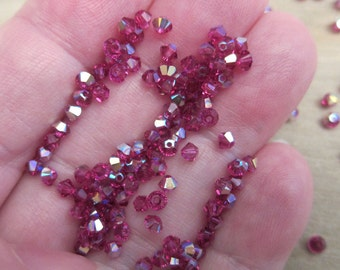 3mm, Swarovski, Art 5328, Faceted Crystal Bicones, Fuchsia AB - Available in 20, 30 & 50 Bead Pkgs, Larger Pkgs and Factory Packs