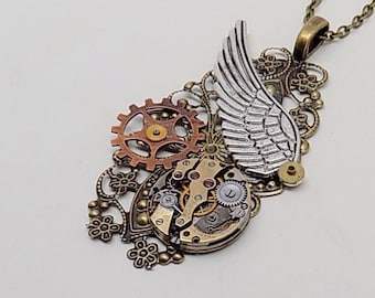 Steampunk jewelry . Steampunk angel wing pendant necklace with vintage watch.