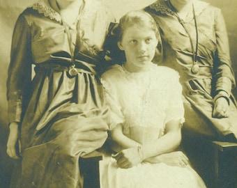 Unsure Shy Sisters Sitting For A Portrait Girls RPPC Real Photo Postcard Vintage Antique Black White Photo Photograph