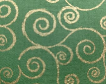 Christmas Fabric Metallic Gold Swirls on Green Background