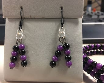 Pruple and black beaded bracelet and earring set