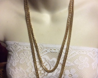 Beautiful gold flat curb chain necklace .