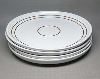 """Denby """" vanilla """"   dinner plates , this listing is for a set of FOUR - these were made 1977 - 1981 . white with brown bands / rings"""