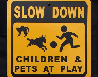 Slow Down Children and Pets At Play 12 inch by 12 inch Metal Sign