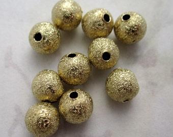 50 pcs. gold tone textured beads 6mm - f4536