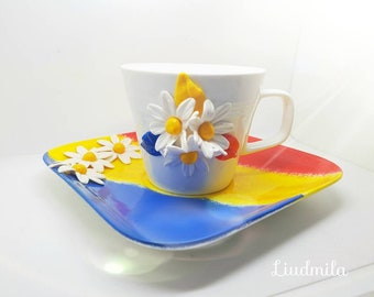Cup decorated by hand